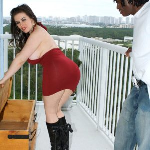 Round brown-haired Daphne Rosen displays off her massive butt in ebony boots on blacony