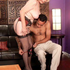 Big-titted aged XXX vid star Lola Lee providing blowjobs in hosiery and lingerie