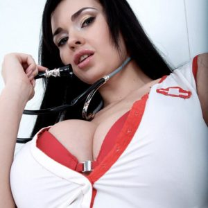 Dark-haired nurse Sha Rizel takes off her uniform to pose in her boulder-holder and panties