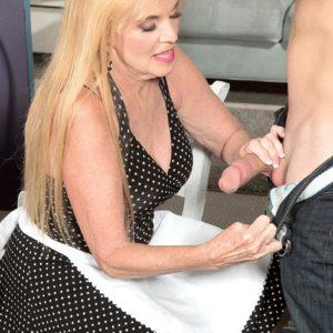 Dressed blonde over 60 MILF Charlie giving CFNM handjob to enormous wood