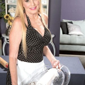 Dressed blonde over 60 MILF Charlie giving CFNM handjob to enormous wood
