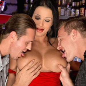 Gorgeous MILF Patty Michova gives two guys oral sex simultaneously in a bar