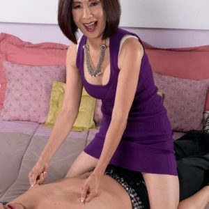 Petite Chinese grandmother Kim Anh showing off white lace panties to seduce younger boy