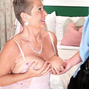 Plump grandma Joanne Price releasing enormous juggs before providing big pecker oral job in hosiery