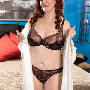 Redheaded Sixty plus MILF hooker Katherine Merlot giving huge dick handjob and blow-job
