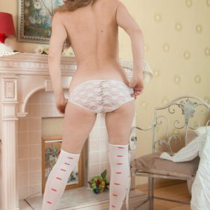 Stocking and lingerie garbed European first timer whipping out wooly pussy