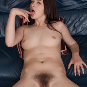 Teenage XXX actress Julia Moore freeing hairy vag from bloomers in pantyhose and stilettos