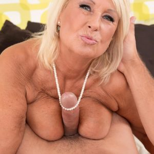 Busty blond grannie in pantyhose and lingerie giving immense knob tit-screwing and BJ