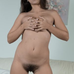 Dark-haired amateur Camille S showing off puny breasts before opening up unshaven fuckbox