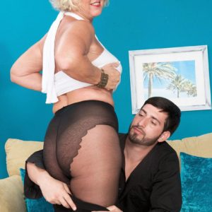 Tights and miniskirt clad grandma Jeannie Lou fellating gigantic cock on knees