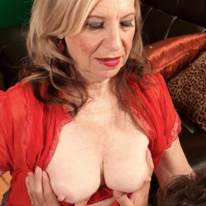 Blond MILF over sixty Miranda Torri revealing massive all-natural hooters and bare ass