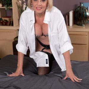 Huge-boobed yellow-haired sixty plus MILF Scarlet Andrews having nips blown and teased