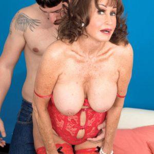 Lingerie adorned dark haired grandmother Jacqueline Jolie uncovering huge hooters for nipple slurping