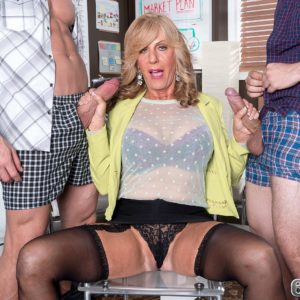 Over sixty blonde MILF Phoenix Skye slurping off gigantic peckers in MMF three-way