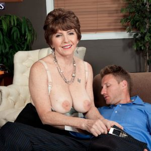 Over sixty MILF Bea Cummins letting large natural boobies fall loose in skirt and high heels