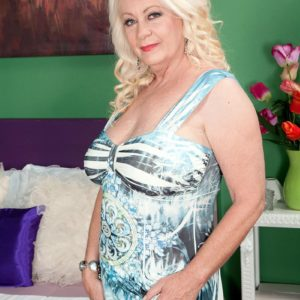 Plump light-haired MILF over Sixty Angelique DuBois releasing pierced swell nipples and gigantic juggs