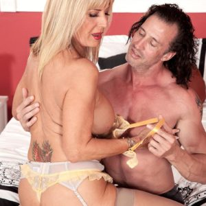 Stocking and lingerie clad older X-rated actress Phoenix Skye extracting large melons and providing rubdown