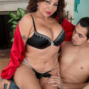 Aged broad Sandra Martines entices a younger guy in melon-holder and panties combo