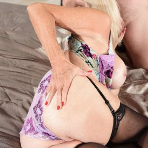 Blonde grannie Leah L'Amour gives her dude toy a handjob in lingerie and hose