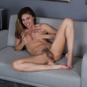 Long-legged brown-haired amateur Chloe R spreading unshaven coochie after nylons removal