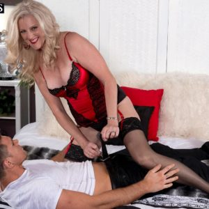 Aged light-haired gal Val Kambel tempts a junior man in mind-blowing lingerie and tights