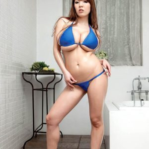 Asian MILF Hitomi pulls out her large titties from her bathing suit top in high heels