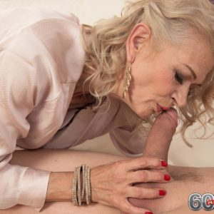 Cool aged gal Beata gives a ball munching blow-job after seducing a junior boy