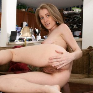 Euro solo female slides off her lingerie to flash her furry slit in the naked