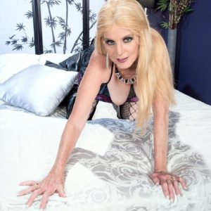 Platinum-blonde grandma Charlie looses her monster-sized juggs in over the knee boots and fishnet bodysuit