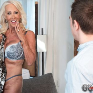 Provocative over 60 MILF Madison Milstar tempts a junior stud in her bra and panties