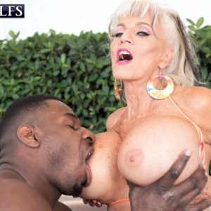 Sex granny Sally D'Angelo and her hefty boobs take on a BBC outdoors in a Jacuzzi