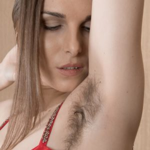 Solo model Donatella flashes off her hairy underarms and slit in nude posing debut
