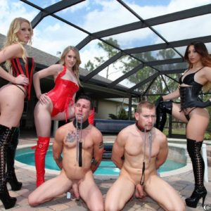 Three Mistresses in fetish garment abuse 2 collared male slaves on the pool patio