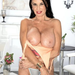 Top mature XXX star Rita Daniels exposes her gigantic fun bags and showcases her underwear as well