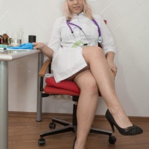 Yellow-haired nurse Jill disrobes in her work environment to showcase her fur covered vag in stilettos