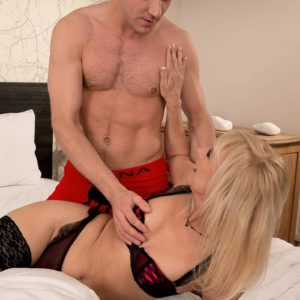 Aged sandy-haired doll munches and deep throats on a big prick in her ebony pantyhose
