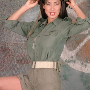 Chinese solo model Minka lets out her immense breasts from her melon-holder army fatigues