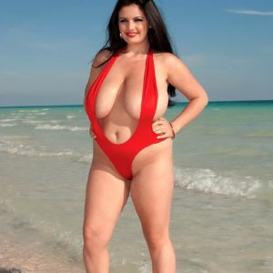 Dark haired BIG SEXY LADY Arianna Sinn extracts her monster-sized boobs from swimsuit at the beach