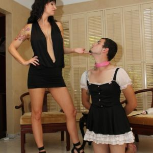 Dark haired mistress Angie Noir face bangs her sissy with a monster-sized strapon sausage in high-heels