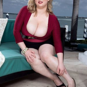 Fat golden-haired female Laddie Lynn flashes her upskirt panties along with her ample cleavage