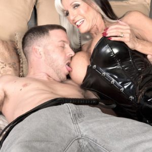 Immense titted Sixty plus MILF Sally D'Angelo wanks a knob in spandex boots and ebony corset