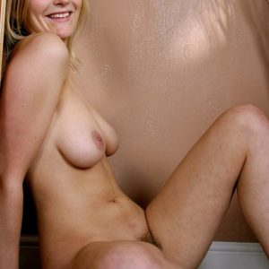 Light-haired solo chick with monster-sized all natural fun bags showcases her unshaven bush while modelling naked