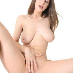 Long-legged stunner Stella Cox exposes her monster-sized natural boobs as she strips to masturbate