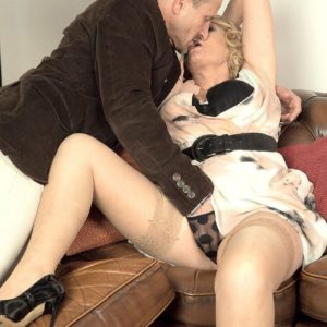 Older fair-haired gal gets around to providing a blowjob after make-out in nylons