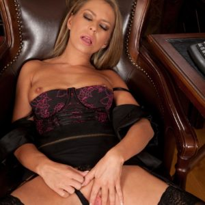 Older MILF with ash-blonde hair reveals her rock hard hooters and vag in her home office place