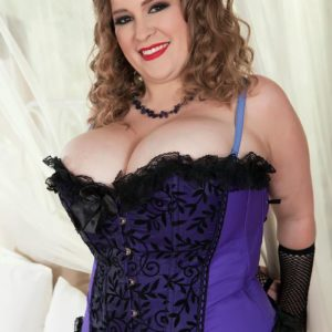 Overweight solo model Smiley Emma exposes her big breasts in mesh hosiery and arm socks