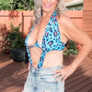 Super-sexy 60 plus MILF Silva Foxx entices a junior man by flaunting her tits in a denim mini-skirt