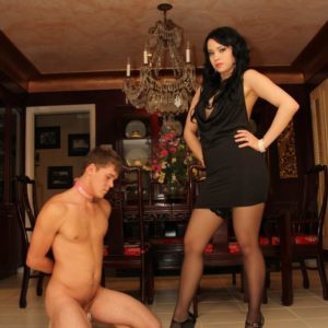 Brown-haired mistress Chloe Cain dominates her naked husband before modeling in stockings