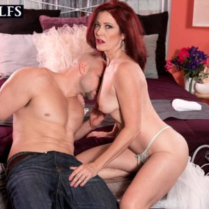 Mature dame with crimson hair Dana Devereaux face sits her toy man after delivering a oral job