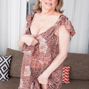 Mature woman Crystal King has her enormous funbags toyed with by a younger guy